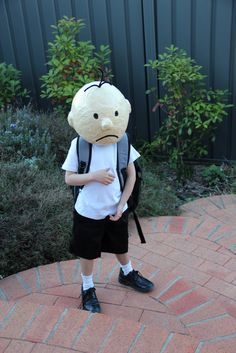 DIARY OF A WIMPY KID   You can get a lot of mileage out of a paper mâché head. Tween boy's book character costume.