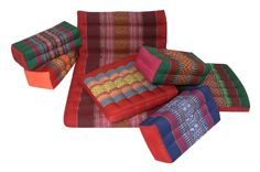 Traditional Thai cushions in vibrant colors with Kapok filling.  http://www.handelsturm.de/shop/