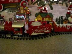 Coca Cola Trains Around the Christmas Tree - YouTube