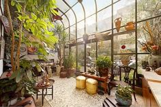 Curved lean-to greenhouse interior - http://garden-greenhouse.se