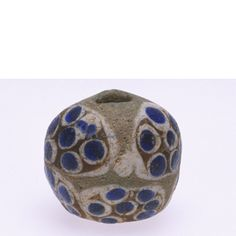 Ancient glass eye bead with rosettes from Anatolia, 2.0 cm diameter.