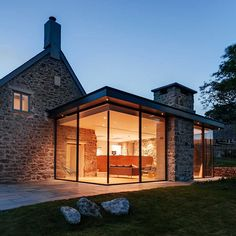 Wide Glass Wall With Fantastic Lamps Decoration As One Of The Modern Extension To The Old Stone House Along With Stone Terrace And Green Court The Modern Extension to the Old Stone House Modern Farmhouse Exterior, Rustic Farmhouse, Urban Farmhouse, Farmhouse Style, Farmhouse Contemporary, Contemporary Building, Contemporary Kitchens, Farmhouse Plans, Contemporary Bedroom