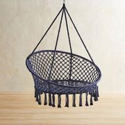 The easy-living leisure of a hammock meets the freewheeling fun of a swing in our delightful, handcrafted saucer chair. Its sturdy wrought iron frame is dressed up with ropes that have been knotted macrame-style to form a laid-back design.