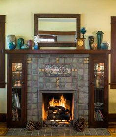Seemingly historic in the tradition of Batchelder tile, the living room's fireplace surround, a handsome focal point, is actually new work by tile artist Laird Plumleigh. Craftsman Tile, Craftsman Fireplace, Craftsman Interior, Craftsman Style Homes, Craftsman Bungalows, Farmhouse Fireplace, Country Fireplace, Farmhouse Decor, Fireplace Tile Surround