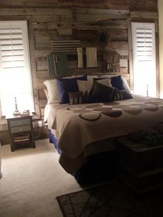 Barn wood wall in Master suite. LOVE. From Knotsandbows.com