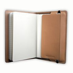 A simple cover for your moleskine -- use and reuse it each time you get a new one. Nice gift idea. I want a white one.
