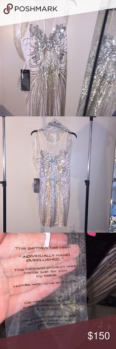 Handmade embellished dress Beautifully handmade embellished dress, size M by brand Bebe. The dress is a light pink, sequins are silver, gold, and a copper. NWT never been worn Could be a dress for a dance, to wear to a wedding, formal.  Feel free to ask any questions and make an offer! Thank you. bebe Dresses