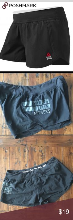 """Reebok CrossFit Knit Shorts Black with """"forging elite fitness"""" on the leg. Comparable to Lululemon speed shorts! 2.5 inseam. Good condition-just some mild pilling at the waist. 4 way stretch! Reebok Shorts"""