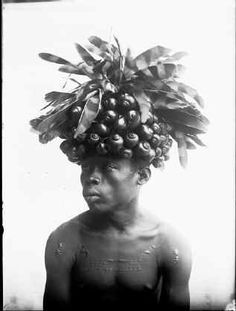 Photo: Herbert Lang Bangba, with a head covered with snails- used in dances. Niangara, Congo Belge, 1913, June.
