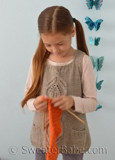 The Kiana Girl's Vest. Great transitional layering piece. Great to knit with gorgeous cable-framed leaf motifs.