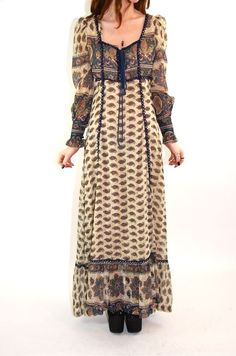 I wore a Gunne Sax Dress very much like this in 1976 to a deb dance.  Wish I still had it.