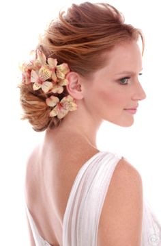 Bride's loose braided chignon bun bridal hair ideas Toni Kami Wedding Hairstyles ♥ ❶ Orchid accents wedding hairstyle ginger
