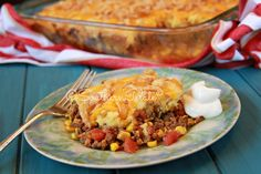 Tamale Pie- Made this and lined cass. dish with a large can of refried beans and omitted can of fried onions.  Trevor loved it!