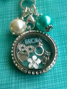 Origami Owl Living Locket Custom Jewelry~ Create your very own today!  Visit my site too see all the charms, dangles and chains you can choose from!  Lockets make great gifts!  www.carrieb.origamiowl.com