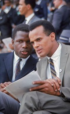 Sidney Poitier and Harry Belafonte take part in the March On Washington (1963)