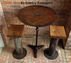 This is a bar height table using antique sawmill blade and base. The stools have already been purchased but table is available for $245. I have a nice piece of glass that goes on top, or could weld a metal rim around blade at no charge.  See more at Big Country Repurposed Furniture on Facebook