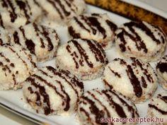 Omlós kókuszos karikák lekvárral töltve. A karikák finom krémmel vannak töltve és kókuszreszelékben forgatva. Ideális sütemény karácsonyra.