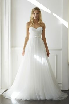 Lisa Gowing - ELSA Ivory tulle hand ruched over ivory silk strapless bodice with sweetheart neckline. Ivory silk buckle belt. A-line layered tulle skirt with sweeping train. Worn with ELIZABETH tulle cape.