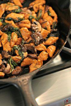 Homemade Sweet Potato Gnoochi, tossed with savory mushrooms, sautéed spinach and fresh rosemary! ~vegan~