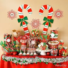 Create a sweet Christmas candy buffet. A gingerbread house makes a wonderful centerpiece! Arranged artfully, candies like colorful gumballs, candy canes. Be sure to provide take-home boxes or party bags so guests can take home some goodies.