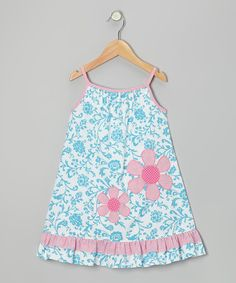 With a ruffled hem and playful print, this lightweight cotton dress has a fun and fancy feel. It's a dress-it-up, dress-it-down confection, complete with a darling keyhole back and bow.