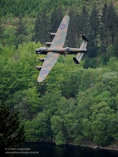 A Lancaster Bomber from the Battle of Britain Memorial Flight, flys over the Derwent Dam, 65 years to the day after the famous Dambuster raid known as Operation Chastise. Derwent Dam was used as a training location prior to the mission.