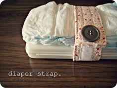 Brilliant! Diaper strap – keeps diaper and wipes together in the big purse. LOVE THIS!