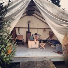 A luxurious tent in the trees with lots of comfy touches for Semi permanent tents