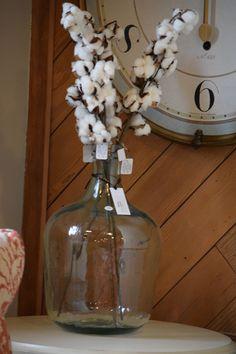 Cotton branch decoration in clear vase. Springtime decor. Gardner Village.