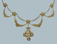 AN ANTIQUE DIAMOND NECKLACE   The front designed as four guirlandes with crescent shaped diamond set connections, supporting a drop shaped as a bouquet des fleurs to a bar link backchain, French, circa 1900, 37.0 cm long