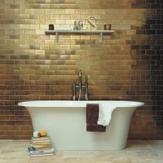 We love the gold metallic tiles, they really make a nice statement piece in a bathroom. www.budgetbathandkitchen.com