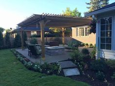 Simple landscape design changes to help transform your backyard experience, including planting choices, lighting, and outdoor structures. Wood Pergola Kits, Pergola Swing, Outdoor Pergola, Outdoor Rooms, Outdoor Dining, Outdoor Decor, Outdoor Ideas, Simple Landscape Design, Free Standing Pergola