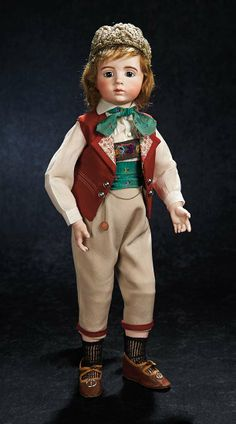 Theriault's. Outstanding and exceptionally rare French bisque art character doll by the noted Parisian sculptor Albert Marque with original signed costume. It is believed that only 100 models of the Marque doll were ever created, most inscribed with their particular number in the series, this being #27. Circa 1916. Upcoming at Theriault's Stein am Rhein auction on March 29th and 30th, 2014 in Naples Florida.   For more info please visit: http://www.theriaults.com/