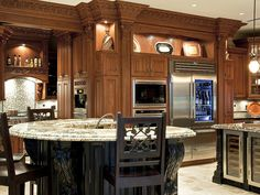 A variety of workstations makes this opulent kitchen a very functional space to prepare a feast