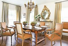 to create a more formal dining room, designer Eleanor Cummings incorporated antiques and vintage pieces throughout the space. the french mirror above the console is from tara shaw antiques. (houston)