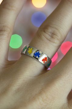 A band of sterling silver encircled with multicolor puzzle pieces becomes an eye-catching display of autism support. Our ring is an expression of the understanding shared by those with a loved one on the spectrum.