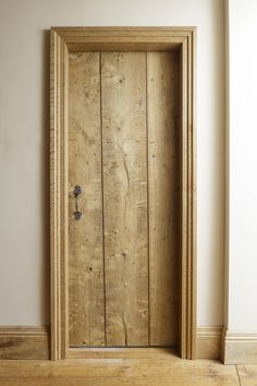 Rustic oak interior door handmade by Jack Badger including bespoke ironmongery. Photo Credit - Adrian Lambert #internaldoor #oakdoor #interiordecorating #interiorinspo #handmade #cottagedoor #farmhousedoor