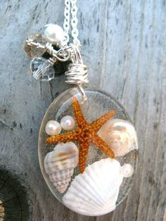 Beach Necklace – Real Sea Shells and Starfish in Resin – Ocean Life Necklace – Beach Pendant – Wire Wrapped Pendant – Resin Jewelry - jewelry diy Seashell Jewelry, Seashell Crafts, Beach Jewelry, Feet Jewelry, Resin Jewlery, Resin Jewelry Making, Diy Resin Crafts, Jewelry Crafts, Bijoux Diy