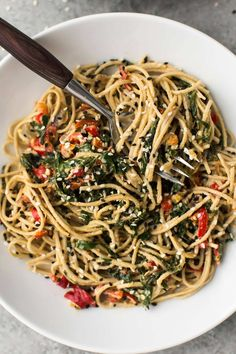 Perfect for crisp, fall greens, this vegan tahini noodle bowl features collards cooked with onions, tossed with soba noodles and a creamy tahini sauce.