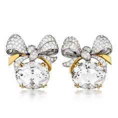 Verdura | Bowknot Earclips. Oval faceted white topaz, diamond and 18k yellow gold.