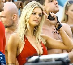 Baring it all: The Sports Illustrated Swimsuit model showed off her ample bosom in the revealing swimsuit that made Pamela Anderson famous Ample Bosom, Revealing Swimsuits, Kelly Rohrbach, Red Swimsuit, Baywatch, Vanity Fair Oscar Party, The Rev, Old Models, Celebs