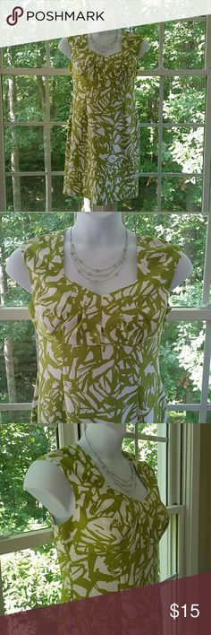 """Ronnie Nicole Lime Green and White Dress Gorgeous lime green and white tropical patterned dress. Cruise maybe? Late summer wedding? Fabulous?  For sure! Back zippered closure. 97% Polyester,  3% Spandex.  Machine washable.  Bust 19-1/2 Waist 17"""" Hips 18-1/2"""" Length 35"""". Thank you for looking! Xoxoxoxoxo Ronnie Nicole  Dresses"""