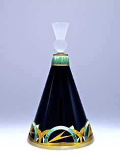 1920s Hoffmann-Czechoslovakian perfume bottle, black crystal, frost dauber-stopper, two-tone gilt metalwork, champleve enameled details. 6 3/4 in.