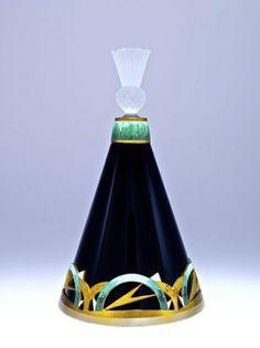 1920s Hoffmann-Czechoslovakian perfume bottle, black crystal, frost dauber-stopper, two-tone gilt metalwork, champleve enameled details. 6 3/4 in.