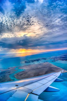 Dawn over Bahrain (out of a plane window) -- Lived here for a year, but never fortunate enough to see this amazing view.