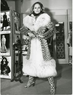Ursula Andress in a cheeta and white fox fur coat at Chombert furs
