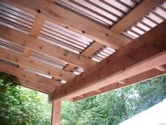 pergola metal roof over deck Deck With Pergola, House With Porch, Decks And Porches, Patio Design, Diy Patio, Curved Pergola, Covered Decks, Corrugated Metal Roof