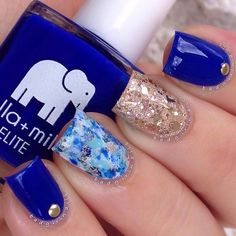 You will love blue more with this amazing nail art design, this blue themed design uses blue to light blue for the base color and details. Gold glitter polish, beads and sequins are also added to further enhance the nails.