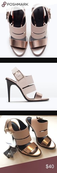 Zara color block metallic heels Brand new with tags Zara heels. Light pink and black with metallic toe strap. Never worn. Size 38/7 1/2 listed on M for lower price. Small scratch on heel strap of one shoe. Zara Shoes Heels
