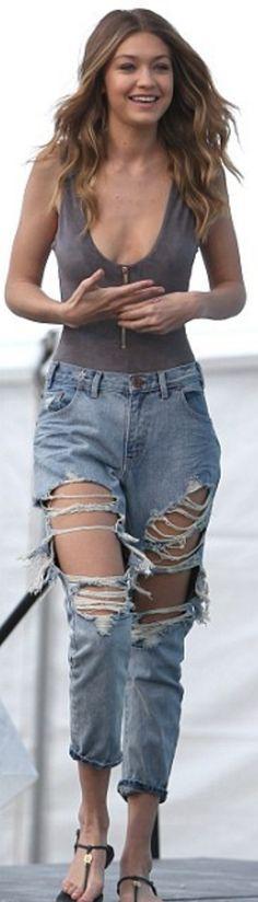 Gigi Hadid: Shirt- House of CB  Jeans – One Teaspoon  Shoes – Tory Burch